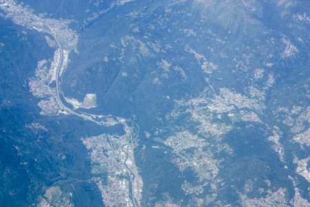aerial view of the Mont Blanc massif between France and Italy at 10,000 feet altitude in the afternoon