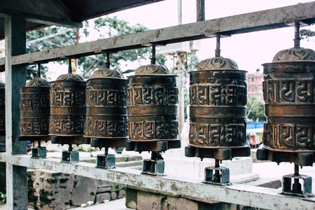 Kathmandu Nepal August 23, 2018 View of Tibetan prayer wheels at the Monkey temple in Swayambhunath area in Kathmandu in the evening Editorial