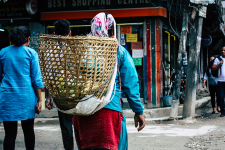 Kathmandu Nepal August 22, 2018 View of unknown Nepali people walking in Thamel street in Kathmandu in the morning Redactioneel