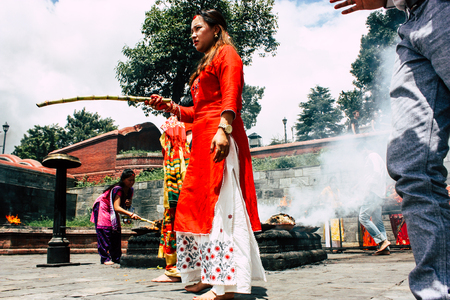 Kathmandu Nepal August 27, 2018 View of unknowns Hindu people making the fire ceremony inside the Pashupatinath temple in the morning Editorial