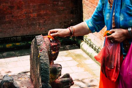 Kathmandu Nepal August 27, 2018 View of unknown Hindu people praying at Pashupatinath temple in the morning Stock Photo - 107772143