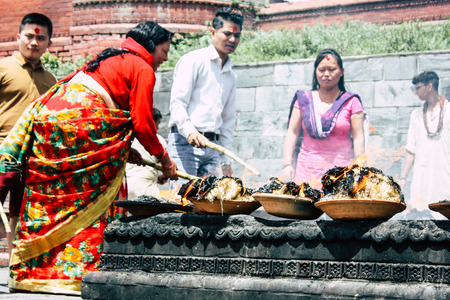 Kathmandu Nepal August 27, 2018 View of unknowns Hindu people making the fire ceremony inside the Pashupatinath temple in the morning Stock Photo - 107772031