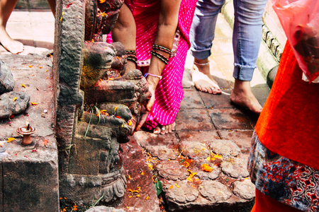 Kathmandu Nepal August 27, 2018 View of unknown Hindu people praying at Pashupatinath temple in the morning Editorial