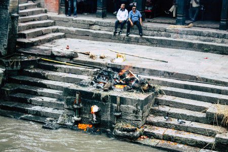 Kathmandu Nepal August 27, 2018 View of the cremation site of a dead body front the river at the temple of Pashupatinath in the afternoon Stock Photo - 107771645
