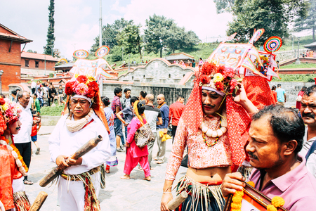 Kathmandu Nepal August 27, 2018 View of unknowns Hindu people attending a religious ceremony at the Pashupatinath temple in the morning