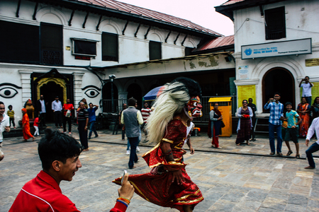 Kathmandu Nepal August 27, 2018 View of young unknowns people attending a religious ceremony where they must run in front of the Hindu demons at the Pashupatinath temple in the morning