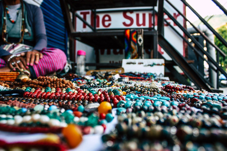 Pokhara Nepal September 26, 2018 Closeup of various handmade jewelry sold by a old woman in the streets of Pokhara in the afternoon Stock Photo