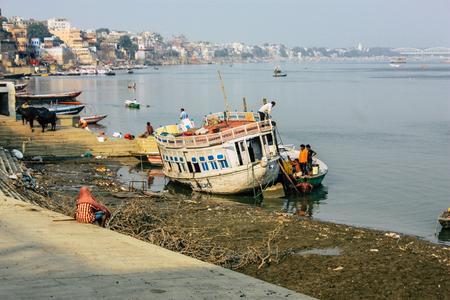 Varanasi India November 8, 2018 View of Indian boats parked at the Ganga river in Varanasi in the afternoon