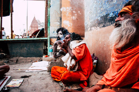 Varanasi India November 8, 2018 Sadhu sitting and smoking the shillum front the Ganges river in the afternoon