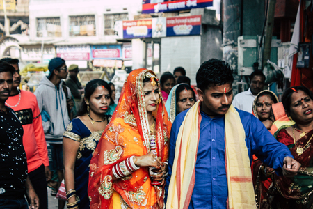 Varanasi India November 19, 2018 View of a unknowns Indian people going to a wedding in the streets of Varanasi in the afternoon