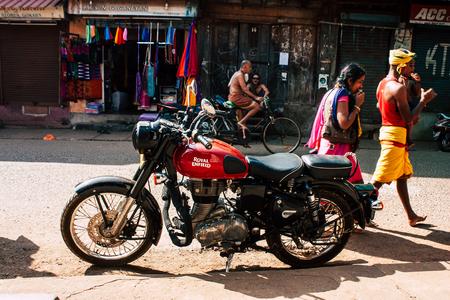 Gokarna Karnataka India December 07, 2018 Closeup of a classic Royal Enfield motorcycle parked in the main street of Gokarna in the morning Editorial