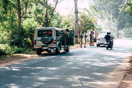 Auroville Tamil Nadu January 24, 2019 View of Indian police officers controling cars at the road to Auroville in southern India in the afternoon