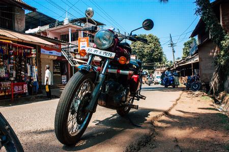 Gokarna Karnataka India February 13, 2019 Closeup of a Royal Enfield motorcycle parked in main road of Gokarna town in the morning