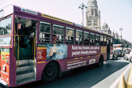 Mumbai India March 2, 2019 View of a traditional local bus rolling in the streets of Mumbai in the morning Editorial