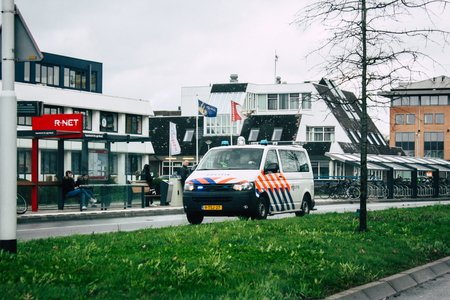 Papendrecht Netherlands March 12, 2019 View of a Duch police car rolling in the streets of Papendrecht in the afternoon