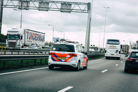 Rotterdam Netherlands March 18, 2019 View of a Dutch police car rolling in the highway in the afternoon Редакционное