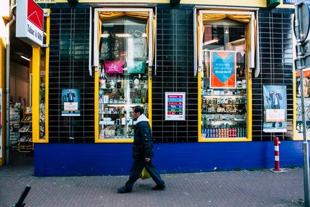 Amsterdam Netherlands April 10, 2019 View of unknown Dutch people walking in Nieuwe Hoogstraat street in Amsterdam in the evening Editorial