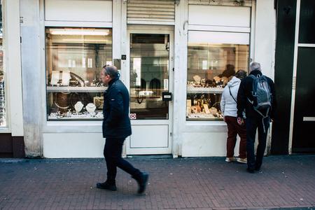 Amsterdam Netherlands April 10, 2019 View of unknown Dutch people walking in Nieuwe Hoogstraat street in Amsterdam in the evening