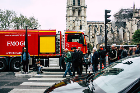 Paris France April 16, 2019 View of a fire truck parked near the Notre Dame cathedral in Paris the day after the big fire in the afternoon
