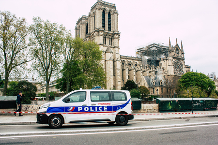 Paris France April 16, 2019 View of a French police car parked near the Notre Dame cathedral in Paris the day after the big fire in the afternoon