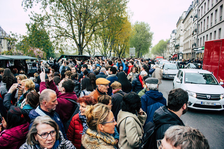 Paris France April 16, 2019 View of Parisians and tourists come to see the Notre Dame cathedral which burned the day before in a big fire Sajtókép