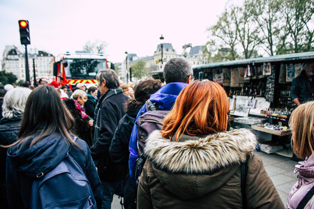 Paris France April 16, 2019  View of Parisians and tourists come to see the Notre Dame cathedral which burned the day before in a big fire Editoriali