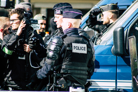 Paris France May 04, 2019 View of a riot squad of the French National Police in intervention during protests of the Yellow Jackets against the policy of President Macron in Paris on saturday afternoon Standard-Bild - 121983030