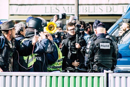 Paris France May 04, 2019 View of a riot squad of the French National Police in intervention during protests of the Yellow Jackets against the policy of President Macron in Paris on saturday afternoon Standard-Bild - 121982894