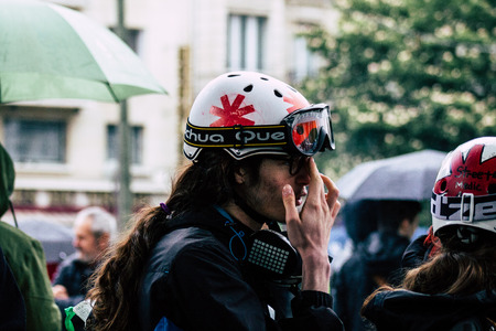 Paris France May 04, 2019 View of French street medic walking in the street during protests of the Yellow jackets against the policy of President Macron in Paris on saturday afternoon Editoriali