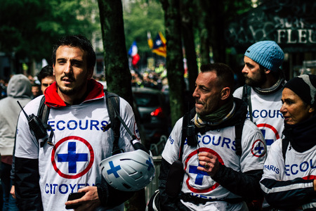Paris France May 04, 2019 View of French street medic walking in the street during protests of the Yellow jackets against the policy of President Macron in Paris on saturday afternoon Redakční