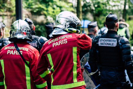 Paris France May 04, 2019 View of a French firefighters walking in the street during protests of the Yellow jackets against the policy of President Macron in Paris on saturday afternoon