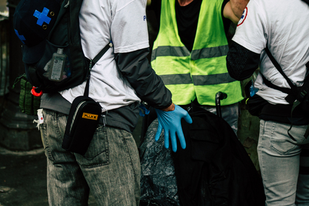 Paris France May 04, 2019 View of French street medic helping a protester injured by the riot squad of the French National Police in the street during protests of the Yellow jackets against the policy of President Macron in Paris on saturday afternoon Editoriali