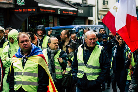 Paris France May 04, 2019 View of Yellow Jackets protesters framed by anti riot police marching against President Macron's policy in Paris on saturday afternoon Éditoriale