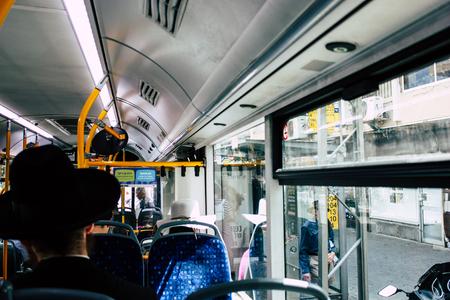 Tel Aviv Israel June 7, 2019 View of unknown Israeli travelling in a city bus of Tel Aviv in the afternoon