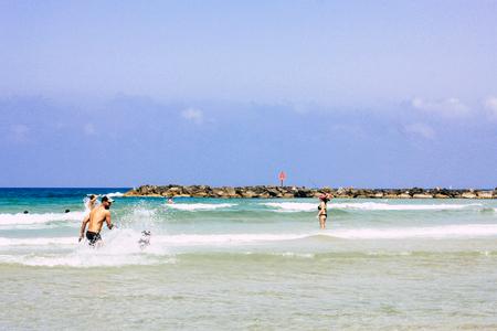 Tel Aviv Israel June 9, 2019 View of unknown Israeli children having fun on the beach of Tel Aviv in the afternoon Editorial