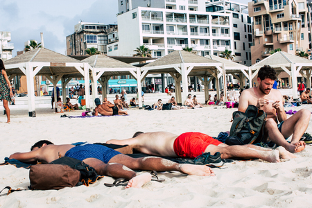 Tel Aviv Israel June 8, 2019 View of unknown Israeli people having fun on the beach of Tel Aviv in the afternoon Editorial