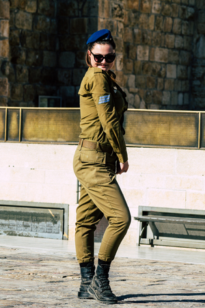Jerusalem Israel June 19, 2019 View of young Israeli woman soldier having fun front the Western wall at the Old city of Jerusalem in the afternoon