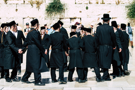 Jerusalem Israel June 19, 2019 View of unknown orthodox Israeli man dancing front the Western wall in the Old city of Jerusalem in the afternoon Redakční
