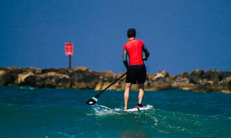 Tel Aviv Israel July 9, 2019 View of unknown Israeli people practicing surfing on Tel Aviv beach in the morning