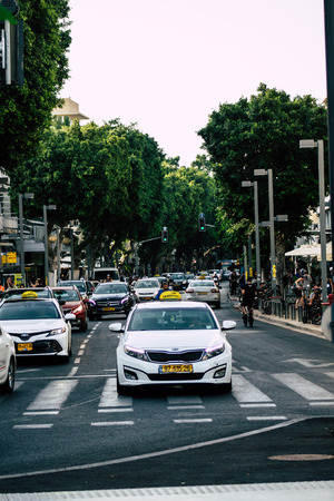 Tel Aviv Israel August 5, 2019 View of traditional Israeli taxi rolling in the streets of Tel Aviv in the afternoon