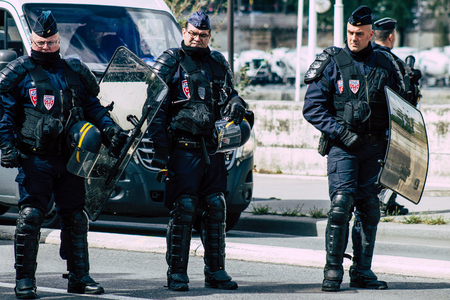 Paris France May 11, 2019 View of men of the French National Police walking in the streets of Paris in the afternoon
