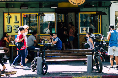 Tel Aviv Israel August 12, 2019 View of unknowns Israeli people eating at a cafe terrace in the streets of Tel Aviv in the afternoon