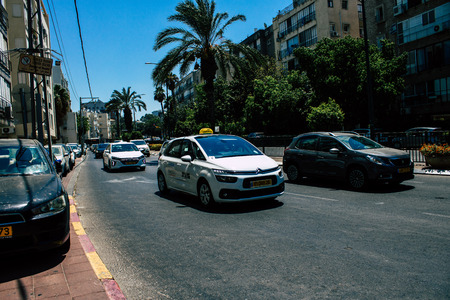 Tel Aviv Israel August 16, 2019 View of traditional Israeli taxi rolling in the streets of Tel Aviv in the afternoon Editorial