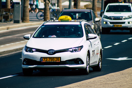 Tel Aviv Israel August 20, 2019 View of traditional Israeli taxi rolling in the streets of Tel Aviv in the afternoon