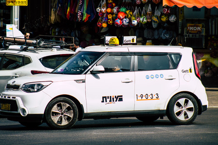 Tel Aviv Israel July 16, 2019 View of traditional Israeli taxi rolling in the streets of Tel Aviv in the afternoon