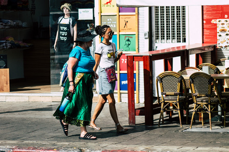 Tel Aviv Israel July 16, 2019 View of unknown people walking in the streets of Tel Aviv in the afternoon