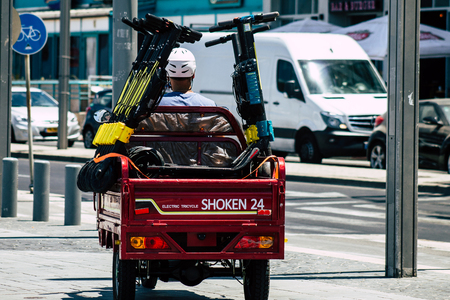 Tel Aviv Israel July 15, 2019 View of unknown Israeli people collecting electric scooters in the streets of Tel Aviv in the afternoon Redakční