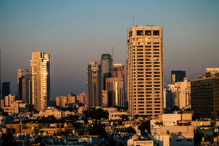 Tel Aviv Israel July 14, 2019 View of skyscrapers from a roof top of a building located in Ben Yehuda street in Tel Aviv in the evening Redakční
