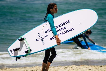 Tel Aviv Israel July 15, 2019 View of unknown Israeli people practicing surfing on Tel Aviv beach in the morning Redakční