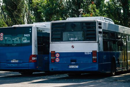 Rome Italy September 15, 2019 View of blue public buses parked at the bus stand in Rome in the morning
